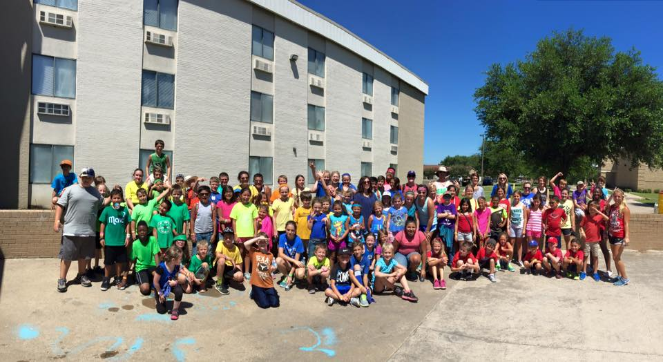 SAGU football coaches host local kids for day camp fun