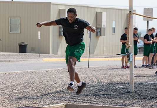 McCray running through one of the obstacles as part of the training program for the Border Patrol Academy
